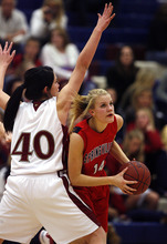 Scott Sommerdorf  l  The Salt Lake Tribune Springville's Mackenzie Neilson looks for a shot while pressured by Herriman's Alicia Reynoso (40) during first half play. Springville beat Herriman 60-21, Friday 1/7/2011.
