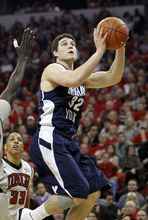 BYU's Jimmer Fredette shoots during the first half of an NCAA college basketball game against UNLV Wednesday, Jan. 5, 2011, in Las Vegas. (AP Photo/Isaac Brekken)