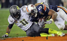 Auburn's Michael Dyer (5) is tackled short of the goal line by Oregon's Eddie Pleasant (11) defends during the second half of the BCS National Championship NCAA college football game Monday, Jan. 10, 2011, in Glendale, Ariz. Auburn won 22-19. (AP Photo/Mark J. Terrill)