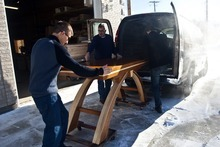 Chris Detrick  |  The Salt Lake Tribune  Craftsman Tom Tosti, center, his son, Dominic Tosti, left, and Lance Reeder load an altar for delivery to Shepherd of the Mountains Lutheran Church in Park City.