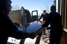 Chris Detrick  |  The Salt Lake Tribune  Craftsman Tom Tosti, left, his son, Dominic Tosti, right, and Lance Reeder load an altar to be delivered to Shepherd of the Mountains Lutheran Church in Park City.