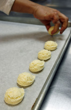 Francisco Kjolseth  |  The Salt Lake Tribune Debora Hammond scoops out small balls of dough featuring her family's recipe for cheese bread, which is a gluten-free product sold in area grocery stores.