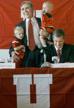 Scott Sommerdorf  |  Salt Lake Tribune University of Utah President Michael Young holds his grandsons Trevor, left, and Bryce Owen as he talks about the University's acceptance of the Pac-10 invitation. Athletic Director Dr. Chris Hill is at right. The University of Utah officially accepted the offer to join the Pac-10 conference.