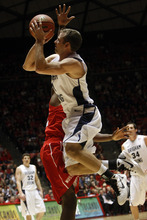 Chris Detrick  |  The Salt Lake Tribune  Brigham Young Cougars guard Jackson Emery #4 shoots past Utah Utes guard/forward Shawn Glover #32 during the game at the Huntsman Center Tuesday January 11, 2011.   BYU won the game 104-79.
