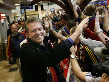 Scott Sommerdorf     Salt Lake Tribune RSL owner Dave Checketts slaps hands Monday of RSL fans as he walks down the line of some of the hundreds of fans who showed up at the airport to greet the team. The Real Salt Lake team brings the MLS cup home to the Salt Lake International Airport.