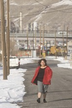 Paul Fraughton  |  The Salt Lake Tribune     Maria Barajas walks through her neighborhood on her way to meet her daughter at West High School on Monday, Jan. 10, 2011.