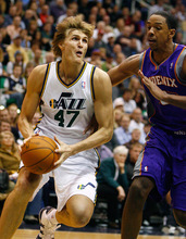 Djamila Grossman  |  The Salt Lake Tribune  Utah Jazz small forward Andrei Kirilenko #47 drives the ball toward the basket as Phoenix Suns center Channing Frye #8 tries to block him at a game in Salt Lake City, Thursday, October 28, 2010. The Jazz lost the game.