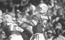 Jim McMahon passing during game. 10/12/80. Tribune archive photo