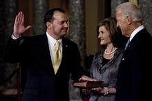 Djamila Grossman     The Salt Lake Tribune Sen. Mike Lee, R-Utah, was sworn in earlier this month by Vice President Joe Biden, as his wife, Sharon, holds the Bible.