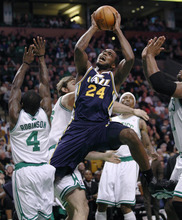 Utah Jazz forward Paul Milsap (24) drives to the basket against Boston Celtics forward Nate Robinson (4) during the first quarter of an NBA basketball game in Boston, Friday, Jan. 21, 2011. (AP Photo/Charles Krupa)