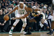 Boston Celtics forward Paul Pierce, left, tries to keep the ball away from Utah Jazz guard CJ. Miles, right, during the first quarter of an NBA basketball game in Boston, Friday, Jan. 21, 2011. (AP Photo/Charles Krupa)