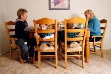 Trent Nelson  |  The Salt Lake Tribune Kelley (left) and Kaye Beeny sit down to dinner with their sons Ben (left) and Sam in their Tooele home. Three years ago, Kaye gave birth to the twins with the help of a sperm donor. The boys call both women,