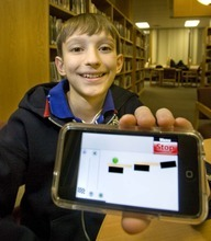 Paul Fraughton  |  The Salt Lake Tribune Robert Nay, a Spanish Fork junior high student, shows off the game he created for the iPhone. The game, called