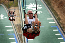Pennsylvanian Steve Wooldridge and his daughter, Rachael, race down the Xtreme Zip at Utah Olympic Park, one of the activities the Utah Athletic Foundation has promoted to expose people to the enjoyment of outdoor recreation, Olympic-style. Tribune file photo