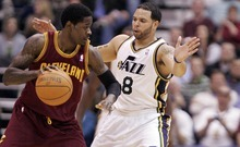 Djamila Grossman  |  The Salt Lake Tribune  The Utah Jazz's Deron Williams, 8, guards Cleveland's Manny Harris, 6, during a game in Salt Lake City, Friday, Jan. 14, 2011. The Jazz won the game.