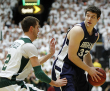 Ed Andrieski  |  The Associated Press Colorado State guard Wes Eikmeier defends as BYU guard Jimmer Fredette looks to pass on Jan. 22.