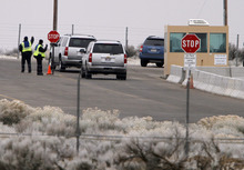 Jim Urquhart  |  The Associated Press Vehicles are stopped at the main gate at Dugway Proving Ground military base Thursday, Jan. 27, 2010, about 85 miles southwest Salt Lake City, Utah. The military base, which carries out tests to protect troops against biological agents and biological attacks, was locked down overnight because a small amount of a nerve agent was unaccounted for. The missing vial prompted a lockdown late Wednesday afternoon that lasted until the agent was found early Thursday. The Army says no one was in danger and the lockdown was ordered as a precaution.