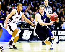 Utah State's Brian Green, right, drives around Texas A&M's B.J. Holmes in the first half of an NCAA first-round college basketball game in Spokane, Wash., Friday, March 19, 2010. (AP Photo/Rajah Bose)