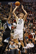 Chris Detrick  |  The Salt Lake Tribune  Utah Jazz small forward Andrei Kirilenko #47 shoots over Minnesota Timberwolves center Nikola Pekovic #14 during the first half of the game at EnergySolutions Arena Friday January 28, 2011.