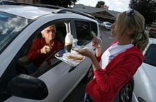 Francisco Kjolseth  |  Tribune file photo     Ed Kosmicki, of Colorado, has his first experience with the signature eats of Hires Big H in Salt Lake City as Jenny Gordon serves him up a root beer float while working the car hop service.  Hires Big H founder Don Hale died Saturday at 93.
