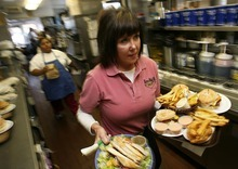 Francisco Kjolseth  |  Tribune file photo Nancy Marks, daughter of Don Hale, the original owner of Hires Big H in Salt Lake City, carries out a large order of specialties during a lunch rush.