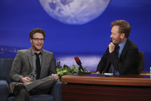 In this photo provided by TBS, Conan O'Brien, right, and guest Seth Rogen are seen during the debut of O'Brien's new TBS show