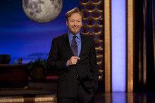 Conan O'Brien performs during the debut of his new TBS show