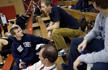 Djamila Grossman  |  The Salt Lake Tribune  Woods Cross High School senior Sasha Prosence chats with his friend Danny Smith before he competes in a wrestling tournament at Bountiful High School, Friday, Jan. 28, 2011.