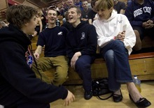 Djamila Grossman  |  The Salt Lake Tribune  Woods Cross High School senior Sasha Prosence, center laughs with his friend, Logan Stewart, left, his friend Danny Smith and his mom, Nancy Prosence after competing in a wrestling tournament at Bountiful High School, Friday, Jan. 28, 2011.