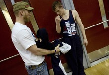 Djamila Grossman  |  The Salt Lake Tribune  Woods Cross High School senior Sasha Prosence gets ready to compete with assistant coach Johnny Hunt,  during a wrestling tournament at Bountiful High School, Friday, Jan. 28, 2011.