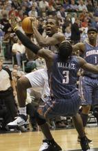 Rick Egan   |  The Salt Lake Tribune  Utah Jazz forward Paul Millsap (24)  goes one on one with Charlotte Bobcats forward, Gerald Wallace (3), in NBA action Utah Jazz vs the Charlotte Bobcats, in Salt Lake City,  Monday, January 31, 2011