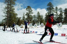 Kirsten Aalberg resumes skiing after shooting three arrows at the 2005 Bryce Canyon Winter Festival's Archery Biathlon. Photo by Janet Reffert.