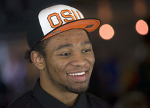 Al Hartmann   |  The Salt Lake Tribune  Salt Lake Valley's football stars descended on Rio Tinto Stadium for a breakfast and signing event.   Highland High School lineman Desmond Collins was all smiles after he signed with Oregon State University.