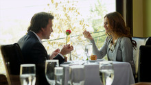 Ned (Curt Doussett) dines with Carol (Michelle Money), his first love interest since his wife's death, in the LDS-themed romance