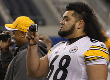 Mark Humphrey |  The Associated Press Pittsburgh Steelers' Chris Kemoeatu takes a picture during media day for NFL football Super Bowl XLV in Arlington, Texas.
