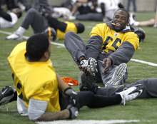 Pittsburgh Steelers linebacker Stevenson Sylvester (55) laughs as he stretches with teammates during practice on Friday, Feb. 4, 2011, in Fort Worth, Texas. The Steelers will play the Green Bay Packers in NFL football Super Bowl XLV Sunday, Feb. 6. (AP Photo/Mark Humphrey)