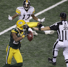 Green Bay cornerback Jarrett Bush celebrates after Pittsburgh receiver Mike Wallace (17) failed to catch a pass on the Steelers' final play.