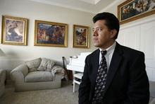 Francisco Kjolseth  |  The Salt Lake Tribune Arturo Morales-LLan is a U.S. citizen who immigrated from Mexico and is a supporter of cracking down on illegal immigration. He has faced backlash for his public stance, including allegations that he illegally worked and hired undocumented labor. Pictured here in his Orem home, he denies the allegations.