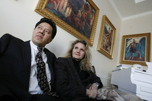 FRANCISCO KJOLSETH | The Salt Lake Tribune Arturo Morales-LLan is an immigrant from Mexico who has formed a group opposing illegal immigration and is an ally of Rep. Steve Sandstrom in his push for an Arizona-style bill. Pictured here with his wife Niki in their Orem home, he denies allegations against him as a smear by political opponents.