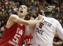 Utah's David Foster, 7 foot 3 inches and 255 pounds, left, battles for position against San Diego State's Brain Carlwell, six foot nine inches and 300 pounds during the second half of an NCAA college basketball game in  San Diego, Tuesday, Feb. 8, 2011. (AP Photo)