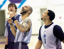 Al Hartmann  |  The Salt Lake Tribune  4/21/2010 Jazz's Kyrylo Fesenko, left, Carlos Boozer and Derron Williams were relaxed and in good spirits during Wednesday's shoot around in Salt Lake City.  They play game 3 against Denver on Friday.