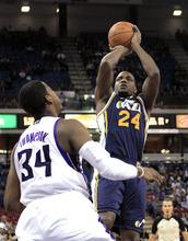 Utah Jazz forward Paul Millsap shoots over Sacramento Kings forward Jason Thompson during the first quarter of an NBA basketball game in Sacramento, Calif., Monday, Feb. 7, 2011. (AP Photo/Rich Pedroncelli)