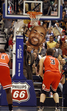 Rick Egan  |  The Salt Lake Tribune  Richard Anderson uses a giant cut out of Carlos Boozer, as he attempts to distract the Bulls' Omer Asik, as he shoots a foul shot, in NBA action Utah vs. Chicago, in Salt Lake City, Wednesday, February 9, 2011