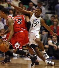 Rick Egan  |  The Salt Lake Tribune  Ronnie Price (17) is blocked by Taj Gibson, in NBA action Utah vs. Chicago, in Salt Lake City, Wednesday, February 9, 2011