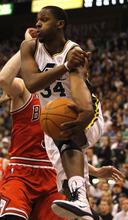 Rick Egan  |  The Salt Lake Tribune  CJ Miles passes the ball off for the Jazz, in NBA action, Utah vs Chicago,  in Salt Lake City, Wednesday, February 9, 2011
