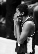 Utah State forward Tai Wesley checks his nose for blood after contact was made with his face during the first half of an NCAA college basketball game against Idaho on Wednesday, Feb. 9, 2011, in Moscow, Idaho. Wesley is wearing a face guard after breaking his nose in practice Monday. (AP Photo/Dean Hare)
