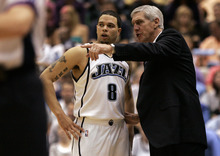 Chris Detrick  |  The Salt Lake Tribune  Utah's Deron Williams and Jerry Sloan talk during the game at EnergySolutions Arena during the first round of the 2007 playoffs.