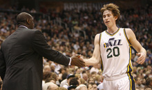 Photo by Chris Detrick | The Salt Lake Tribune  Utah Jazz head coach Tyrone Corbin high fives Utah Jazz small forward Gordon Hayward (20) during the game against Phoenix at the EnergySolutions Arena Friday February 11, 2011.