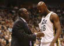 Photo by Chris Detrick | The Salt Lake Tribune  Utah Jazz head coach Tyrone Corbin talks with Utah Jazz center Francisco Elson (16) during the game against Phoenix at the EnergySolutions Arena Friday February 11, 2011.
