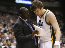 Photo by Chris Detrick | The Salt Lake Tribune  Utah Jazz head coach Tyrone Corbin talks with Utah Jazz center Kyrylo Fesenko (44) during the game against Phoenix at the EnergySolutions Arena Friday February 11, 2011.